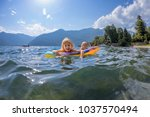 twins sisters swimming in the... | Shutterstock . vector #1037570494
