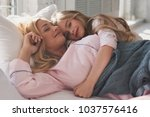 pure love. mother and daughter... | Shutterstock . vector #1037576416
