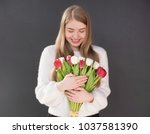 girl with tulips  woman holding ... | Shutterstock . vector #1037581390