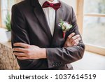 guy in a suit and a bow tie is... | Shutterstock . vector #1037614519