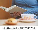 sitting woman reading a book at ... | Shutterstock . vector #1037636254