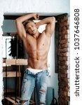 young sexy muscular man   Shutterstock . vector #1037646808