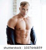 young sexy muscular man | Shutterstock . vector #1037646859