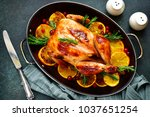 roasted chicken with oranges ... | Shutterstock . vector #1037651254
