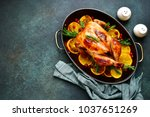 Small photo of Roasted chicken with oranges ,rosemary and cranberries in a skillet pan.Top view with copy space.