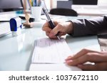 close up of a businessperson's... | Shutterstock . vector #1037672110