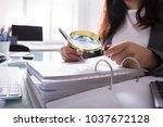 close up of a businesswoman's... | Shutterstock . vector #1037672128