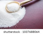 sprinkled sugar and a wooden... | Shutterstock . vector #1037688064