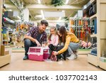 Stock photo family buying supplies for little puppy in petshop 1037702143