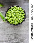 peeled green peas in a plate on ... | Shutterstock . vector #1037702464