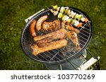 grilling meat in flames  tasty... | Shutterstock . vector #103770269