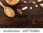 raw peanuts in a peel on a... | Shutterstock . vector #1037702860
