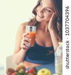 girl sitting in kitchen on the...   Shutterstock . vector #1037704396