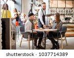 waiter bringing a sweet dessert ... | Shutterstock . vector #1037714389