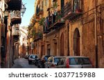a narrow street with washing... | Shutterstock . vector #1037715988