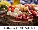 assorted deli meats and a plate ... | Shutterstock . vector #1037730424