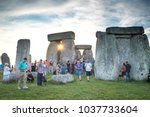 Small photo of Wiltshire/England - June 20, 2017: During the annual summer solstice celebration at Stonehenge, visitors can get as close to the circle of stones as they like. The celebration lasts all night.