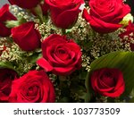 Stock photo detailed close shot of velvet red roses in romantic valentines bouquet 103773509