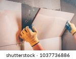 the working tiler mounts on the ... | Shutterstock . vector #1037736886