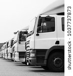 lorries parked up outside a... | Shutterstock . vector #1037737873