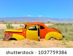 abandoned derelict old car in... | Shutterstock . vector #1037759386