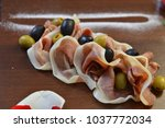 salad of cold cuts with olive ... | Shutterstock . vector #1037772034