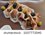 salad of cold cuts with olive ... | Shutterstock . vector #1037772040