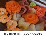 mixed seafood salad in dish the ... | Shutterstock . vector #1037772058