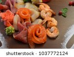 mixed seafood salad in dish the ... | Shutterstock . vector #1037772124