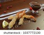 shrimp fried in breadcrumbs.... | Shutterstock . vector #1037772130
