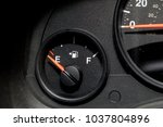 low fuel guage shown in a car... | Shutterstock . vector #1037804896