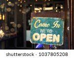 open sign hanging outside a... | Shutterstock . vector #1037805208