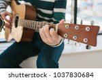 learning to play the guitar.... | Shutterstock . vector #1037830684