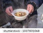 feeding homeless people on the... | Shutterstock . vector #1037831068