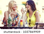 young and attractive women are... | Shutterstock . vector #1037869909