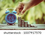 close up hand holding coin ... | Shutterstock . vector #1037917570