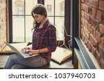 young smiling woman with laptop ... | Shutterstock . vector #1037940703
