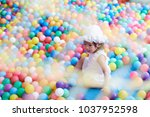 asian little girl play with...   Shutterstock . vector #1037952598