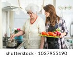 happy grandmother and her... | Shutterstock . vector #1037955190
