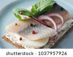 Stock photo a traditional sandwich with a young herring on black bread cream cheese herring fillets a hard 1037957926
