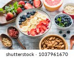 acai smoothie bowl with granola ... | Shutterstock . vector #1037961670