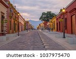 oaxaca city street  evening.... | Shutterstock . vector #1037975470