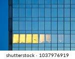 a single illuminated office... | Shutterstock . vector #1037976919