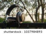 headphones on the bokeh... | Shutterstock . vector #1037984893