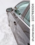 Small photo of car stuck in snow. winter concept, bad weather