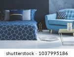 blue sofa with patterned... | Shutterstock . vector #1037995186
