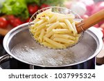 cooking pasta in a pot with... | Shutterstock . vector #1037995324