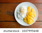 thai mango and sticky rice with ... | Shutterstock . vector #1037995648