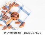 dates fruit in wooden ladle on... | Shutterstock . vector #1038027673