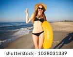 young pretty blonde woman...   Shutterstock . vector #1038031339